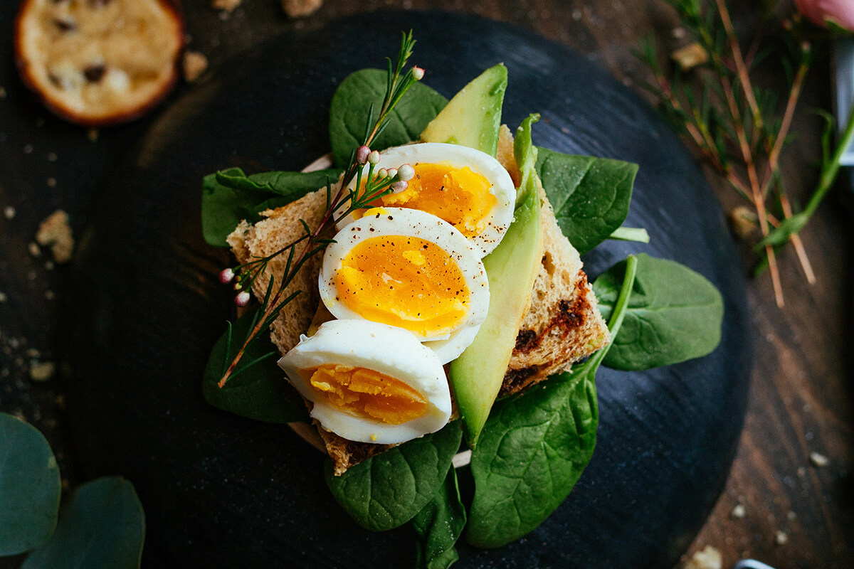 Start the day right with vibrant green veg and an oozing poached egg.